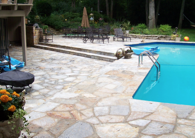 Natural Stone pool deck installation