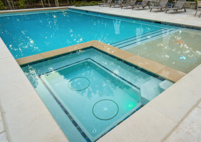 natural stone pool deck in lake forest